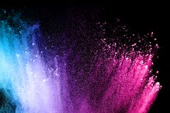 Multi color powder explosion isolated on black background. Colorful dust splatter on dark background stock photos