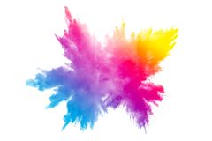 Multi color powder explosion on white background. Colorful dust particles splashing on background stock image