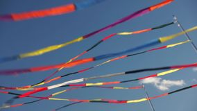 Multi color ribbon flags fluttering stock video