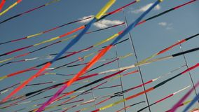 Multi color ribbon flags fluttering stock video footage