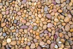 Multi color rock pebbles background. Texture Stock Photos