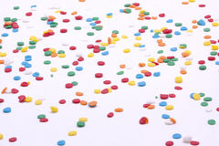 Multi color round sprinkles on white background Stock Image