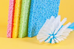 Multi color sponges and brush. For cleaning Stock Photography