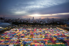 Multi-color tents at the train night market in Bangkok. This is a must visit .The Train night market at Ratchada road in Bangkok Thailand, with tons of food Stock Photo