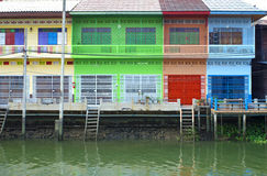 Multi color Thai style houses beside canal Stock Images