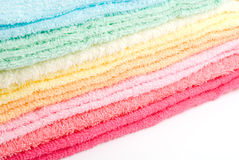 Multi color towels. Multi color laden towels on a white background Royalty Free Stock Photo