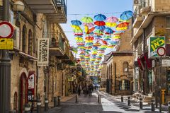 Multi-color umbrella display hanging high over a street Stock Photography