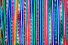 Multi color vivid tone stripe of Peruvian fabric for background. Banner or texture royalty free stock images