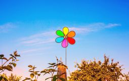 Multi-color a weather vane - the propeller against the background of the sky.  stock images