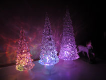 Multi-colored acrylic trees with acrylic horse Royalty Free Stock Image