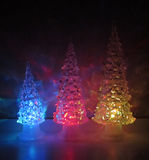 Multi-colored acrylic trees with acrylic horse Stock Images