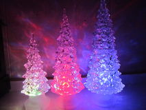 Multi-colored acrylic trees with acrylic horse Royalty Free Stock Images