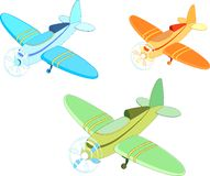 Multi-colored aircrafts. Three multi-colored toy aircrafts Stock Photos