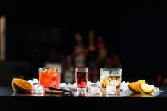 Multi-colored alcoholic cocktails with citrus in glasses of different shapes on the bar. stock image