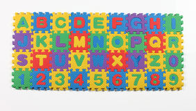 Multi colored alphabet puzzle. On white background Royalty Free Stock Image