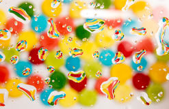 Multi-colored background with reflection in water drops Stock Image