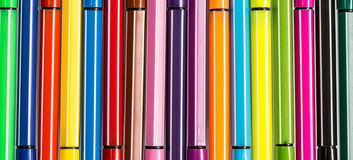 Multi-colored ball pens background Stock Photography