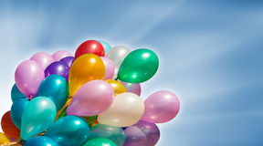 Multi-colored balloons on blue sky background Royalty Free Stock Photography