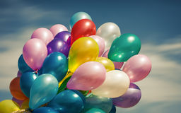 Multi-colored balloons on blue sky background Stock Image