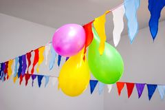 Multi-colored balloons with flags decorate solemn event, feast_ royalty free stock photo