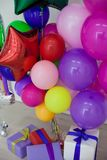 Multi-colored balloons and gifts for the holiday. 1 Royalty Free Stock Image
