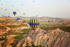 Multi-colored balloons in the sky of Cappadocia Stock Images