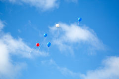 Multi colored balloons in the sky Stock Image