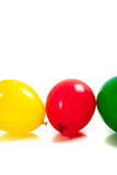 Multi-colored balloons on white Royalty Free Stock Photography