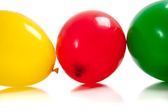 Multi-colored balloons on white Stock Images