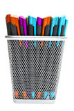 Multi-colored ballpoint pens in pencil holders. On white Royalty Free Stock Photo