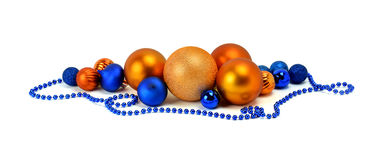 Multi-colored balls and beads . Christmas tinsel. / Isolated /. Stock Photos