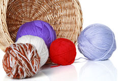 Multi-colored balls of yarn in wicker basket Royalty Free Stock Images
