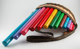 Multi-colored bamboo pan flute Royalty Free Stock Images