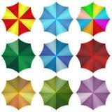 Multi colored beach umbrellas. Vector illustration Stock Image