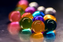 Multi-colored beads absorb water. Abstract background. Multi-colored beads absorb water. Abstract background royalty free stock image