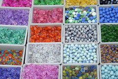 Multi colored beads and tools for making jewelry and crafts.  Royalty Free Stock Photos