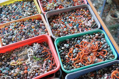 Multi colored beads and tools for making jewelry and crafts, Pushkar, India.  Stock Photo