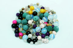 Multi-colored beads on a white background Royalty Free Stock Photography
