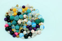 Multi-colored beads on a white background Stock Images
