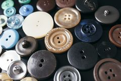 Multi-colored big buttons close-up on a black background.  Stock Photo