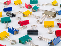 Multi Colored Binder Clips 1. Medium sized multi-colored binder clips taken on a blank background, not pure white Royalty Free Stock Photography