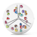 Multi colored bingo balls turning inside glass sphere. 3D illustration.  Stock Photos