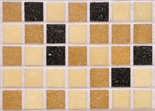 Orange mosaic tiles,pattern seamless for decoration. Multi-colored black orange brown and yellow square rough matte mosaic tiles, pattern seamless for decoration stock photos