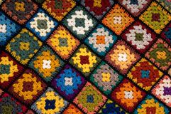 Multi colored blanket. Baby blanket of granny squares Stock Photography
