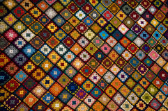Multi colored blanket. Afghan of granny squares in many colors Stock Photos