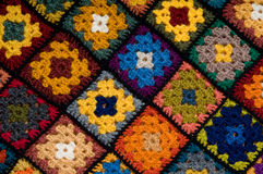 Multi colored blanket. Colorful Blanket of granny squares Stock Images