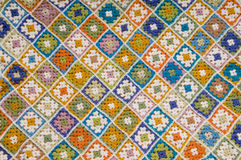 Multi colored blanket. Baby blanket of granny squares Royalty Free Stock Images