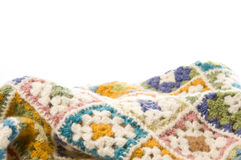 Multi colored blanket in wool. Blanket made of granny Squares Stock Photos