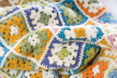 Multi colored blanket in wool. Blanket made of granny Squares Royalty Free Stock Image