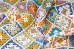 Multi colored blanket in wool. Blanket made of granny Squares Stock Image